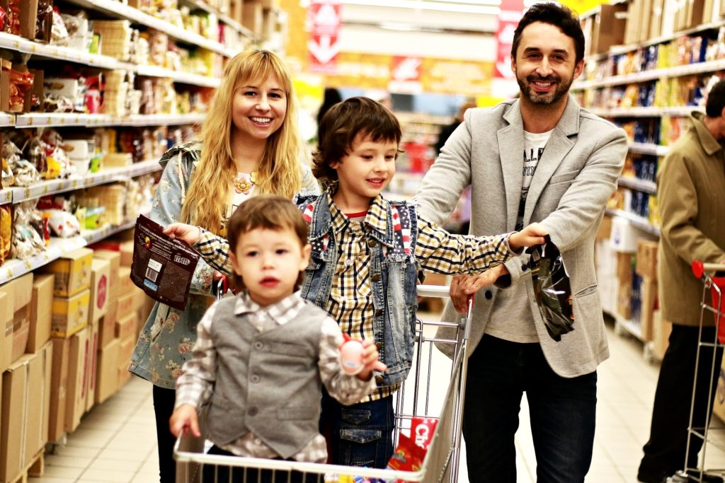 Happy family walking in a grocery store