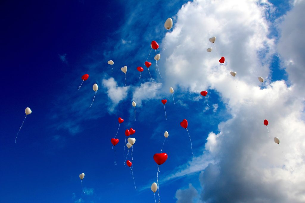 Heart shaped balloons floating in air