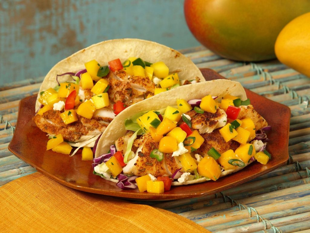 Fish tacos with a mango salsa and other seasonings.